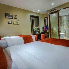 Отель Oriental Suites Ханой комната для гостей