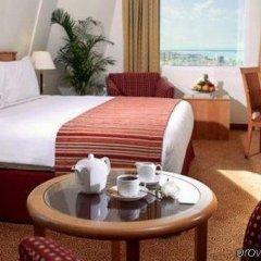 Отель Swiss-Belhotel Sharjah в номере фото 2
