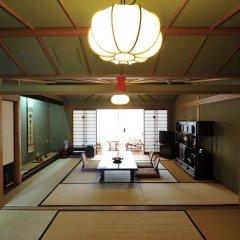 Отель Nisshokan Bettei Koyotei Нагасаки в номере