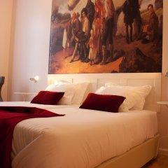 Отель Lisbon Arsenal Suites Лиссабон комната для гостей