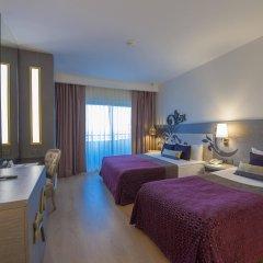 Отель Kirman Belazur Resort And Spa Богазкент комната для гостей