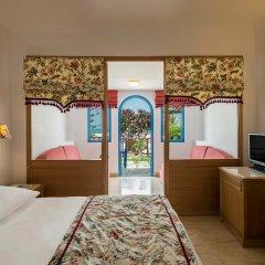 Отель Mitsis Rinela Beach Resort & Spa - All Inclusive удобства в номере