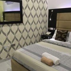 Отель Millennium Apartments Нигерия, Лагос - отзывы, цены и фото номеров - забронировать отель Millennium Apartments онлайн комната для гостей фото 2
