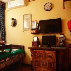 Отель Beijing Double Happiness Hotel Китай, Пекин - отзывы, цены и фото номеров - забронировать отель Beijing Double Happiness Hotel онлайн удобства в номере фото 2