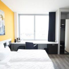 Отель carathotel Düsseldorf City комната для гостей фото 2