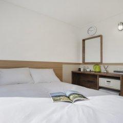 Отель Kennystoryinn Jongro Южная Корея, Сеул - отзывы, цены и фото номеров - забронировать отель Kennystoryinn Jongro онлайн сейф в номере