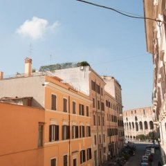 Отель Appartamento Santi Quattro 1 E 2 Colosseo