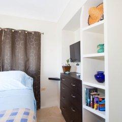 Отель The Bailey's New Kingston Suites удобства в номере