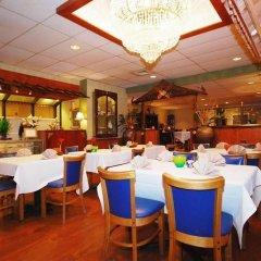 Отель Magnuson Grand Columbus North США, Колумбус - отзывы, цены и фото номеров - забронировать отель Magnuson Grand Columbus North онлайн питание фото 3