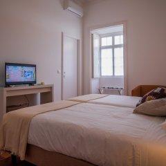 Отель CC Guest House - Ao Mercado Португалия, Понта-Делгада - отзывы, цены и фото номеров - забронировать отель CC Guest House - Ao Mercado онлайн комната для гостей