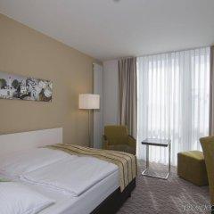 Отель Holiday Inn Munich-Unterhaching Германия, Унтерхахинг - 7 отзывов об отеле, цены и фото номеров - забронировать отель Holiday Inn Munich-Unterhaching онлайн комната для гостей фото 4