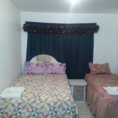 Отель Sweets Guest House Ямайка, Монтего-Бей - отзывы, цены и фото номеров - забронировать отель Sweets Guest House онлайн комната для гостей фото 2
