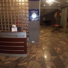 Отель Golden Tulip Airport Hotel Нигерия, Варри - отзывы, цены и фото номеров - забронировать отель Golden Tulip Airport Hotel онлайн интерьер отеля