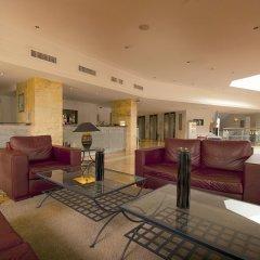 Отель Vila Gale Cerro Alagoa Hotel Португалия, Албуфейра - отзывы, цены и фото номеров - забронировать отель Vila Gale Cerro Alagoa Hotel онлайн интерьер отеля