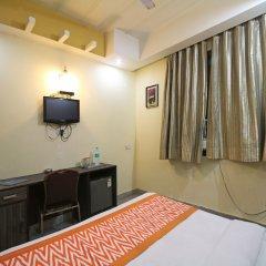 Отель OYO 5943 TJS Grand удобства в номере фото 2