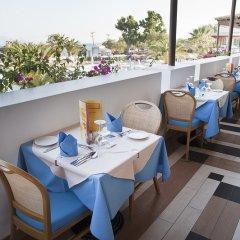 Отель Aegean Village Hotel Греция, Мастичари - отзывы, цены и фото номеров - забронировать отель Aegean Village Hotel онлайн питание
