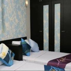 Отель Chitra Suite Spa Бангкок комната для гостей