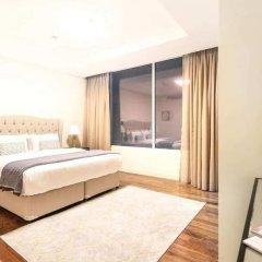 Отель Bright and Luxurious Apt in the Heart of Difc! Дубай комната для гостей фото 3