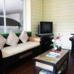 Апартаменты At Home Executive Apartment Паттайя комната для гостей