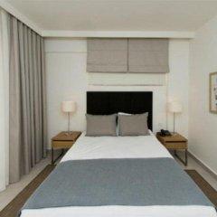 Апартаменты Kusadasi Golf and Spa Apartments Сельчук комната для гостей фото 4