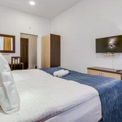 Гостиница Rotas City Center комната для гостей фото 4