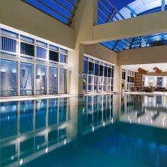 Отель Grand Millennium Al Wahda бассейн