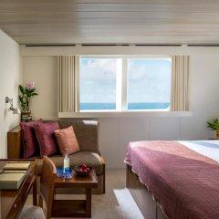 Отель Four Seasons Resort Maldives at Kuda Huraa комната для гостей фото 3
