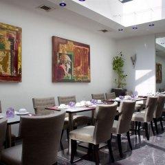 Отель Auteuil Manotel Швейцария, Женева - 1 отзыв об отеле, цены и фото номеров - забронировать отель Auteuil Manotel онлайн питание фото 2