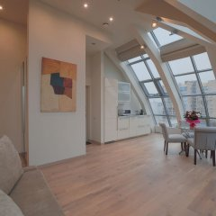 Апартаменты Arbat House Apartments on Bolshaya Nikitskaya комната для гостей фото 2