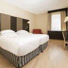 NH Geneva Airport Hotel комната для гостей