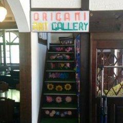 Отель Lodge Karunaju & The Alpine Grill Хакуба банкомат