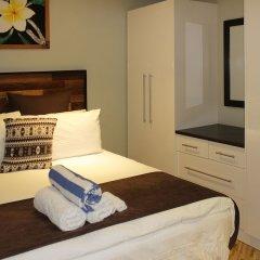 Апартаменты GreyStone Apartments 03 комната для гостей