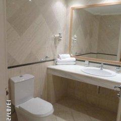 Отель Mitsis Family Village Beach Hotel Греция, Калимнос - отзывы, цены и фото номеров - забронировать отель Mitsis Family Village Beach Hotel онлайн ванная фото 2