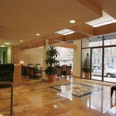Отель Aparto Suites Muralto интерьер отеля фото 3