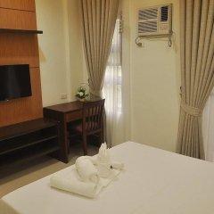 Отель Rishan Village Residences Филиппины, Пампанга - отзывы, цены и фото номеров - забронировать отель Rishan Village Residences онлайн