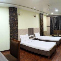 Hotel puneet international комната для гостей