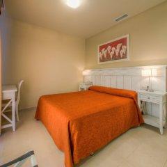 Отель Apartamentos Piedramar Испания, Кониль-де-ла-Фронтера - отзывы, цены и фото номеров - забронировать отель Apartamentos Piedramar онлайн комната для гостей фото 4