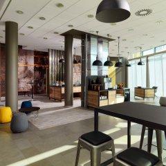 Отель Courtyard by Marriott Berlin City Center фитнесс-зал