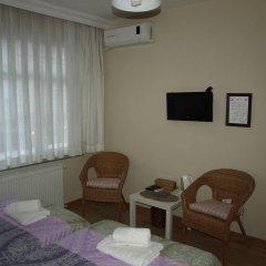 Апартаменты Midillis Art Apartment комната для гостей фото 2