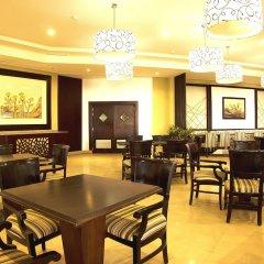 Апартаменты Pyramisa Sunset Pearl Apartments интерьер отеля