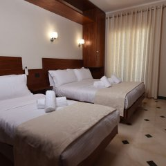 Отель Pandora Residence Албания, Тирана - отзывы, цены и фото номеров - забронировать отель Pandora Residence онлайн комната для гостей фото 3