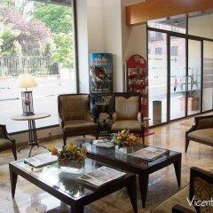 Отель Aparto Suites Muralto интерьер отеля фото 2