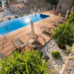 Отель Arbiana Heritage бассейн
