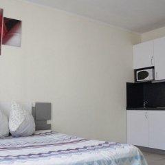 Апартаменты LOFT STUDIO Oktyabrya 52 в номере фото 2