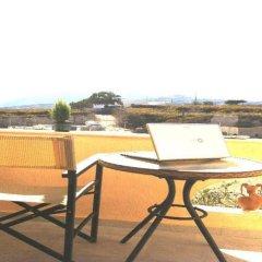 Отель Emmanouela Studios Греция, Остров Санторини - отзывы, цены и фото номеров - забронировать отель Emmanouela Studios онлайн балкон
