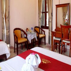 Отель Nhi Nhi Хойан в номере фото 2