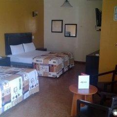 Hotel Aquiles сейф в номере