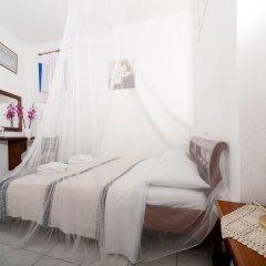 Отель Georgis Apartments Греция, Остров Санторини - отзывы, цены и фото номеров - забронировать отель Georgis Apartments онлайн комната для гостей фото 2