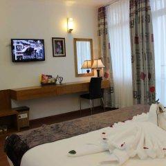 Отель Family Hanoi Hotel Вьетнам, Ханой - отзывы, цены и фото номеров - забронировать отель Family Hanoi Hotel онлайн удобства в номере фото 2