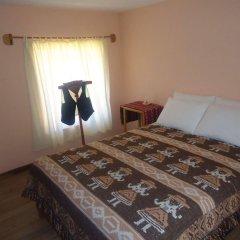 Отель Titicaca Lodge комната для гостей